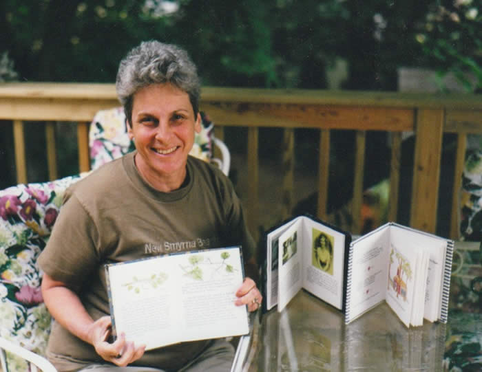 Ann Cutler with handmade books of family stories